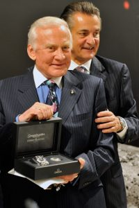 Buzz Aldrin, left, gets a watch from Stephen Urquhart, right, during a press conference at the Omega booth at the world watch and jewellery show 'Baselworld' in Basel, Switzerland, Saturday, March 28, 2009. Omega presented the 'Omega Speedmaster Professional Moonwatch Apollo 11 40th Anniversary Limited Edition' wristwatch in presence of the astronauts.