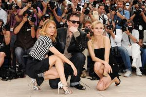 Actress Melanie Laurent with director Quentin Tarantino and Diane Kruger, wearing a Jaeger-LeCoultre reverso squadra lady in pink gold attend the Inglourious Basterds Photocall held at the Palais Des Festivals during the 62nd International Cannes Film Festival on May 20, 2009 in Cannes, France. (Photo by Pascal Le Segretain/Getty Images)