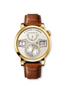LANGE ZEITWERK, yellow gold, dial champagne, time bridge made of untreated German silver. Manually wound, jumping hours and minutes, small seconds hand with stop seconds, power-reserve indicator.