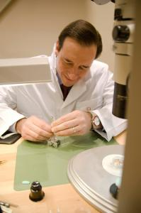 Dave Cobb, Executive Vice-President and DEputy CEO of the Vancouver Organizing Committee for the 2010 Olympic and paralympic winter games behind watchmaker bench at the OMEGA Olympic boutique in Vancouver