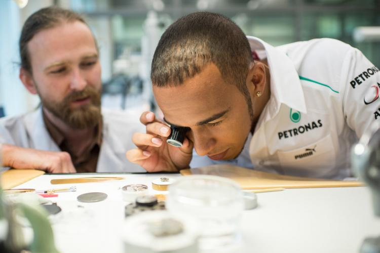 Lewis Hamilton looking at an IWC watch