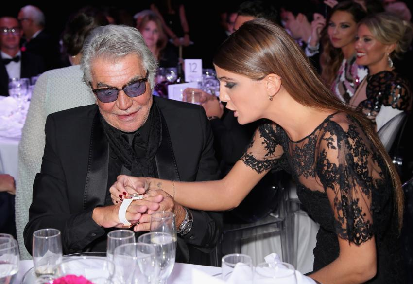 The winning bidder, designer Roberto Cavalli with Bianca Brandolini d'Adda