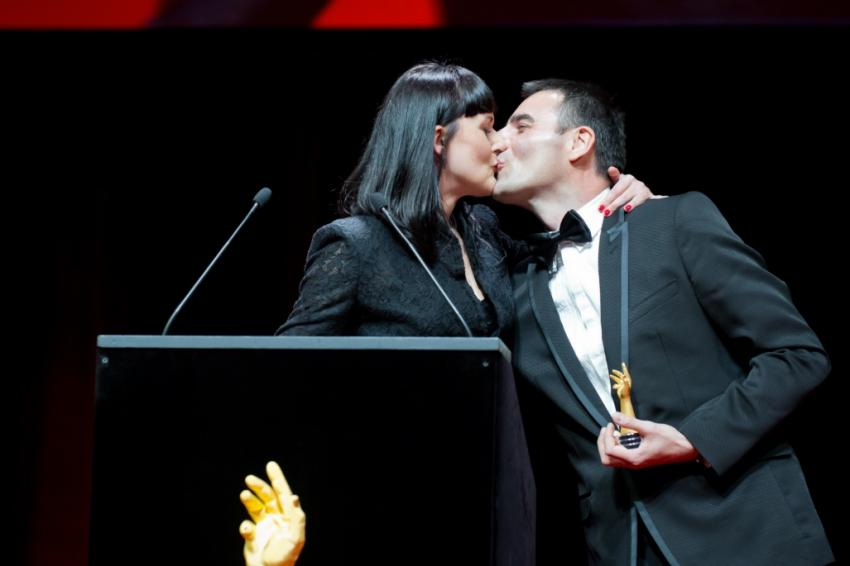 Maria and Richard Habring sharing a kiss on stage at the 2013 GPHG.
