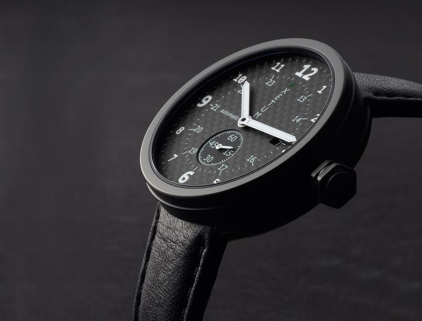 Xetum PVD Tyndall Carbon Fiber: Black PVD surgical stainless steel case and black naturally tanned leather strap with Italian cork lining