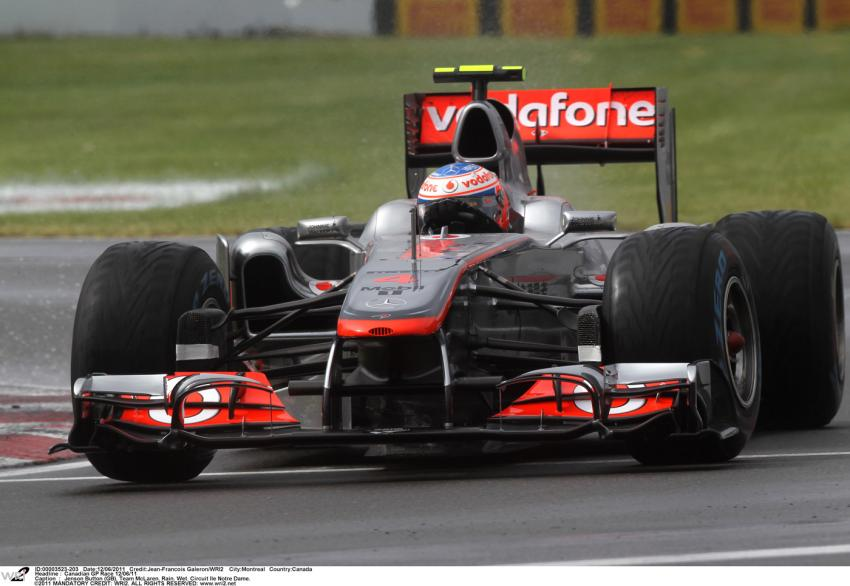 June 2011: Jenson Button driving a McLaren on the Gilles Villeneuve circuit in Montreal.