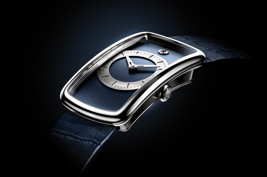 Curved shaped platinum case of the Badollet Ivresse is designed to embrace wrist.