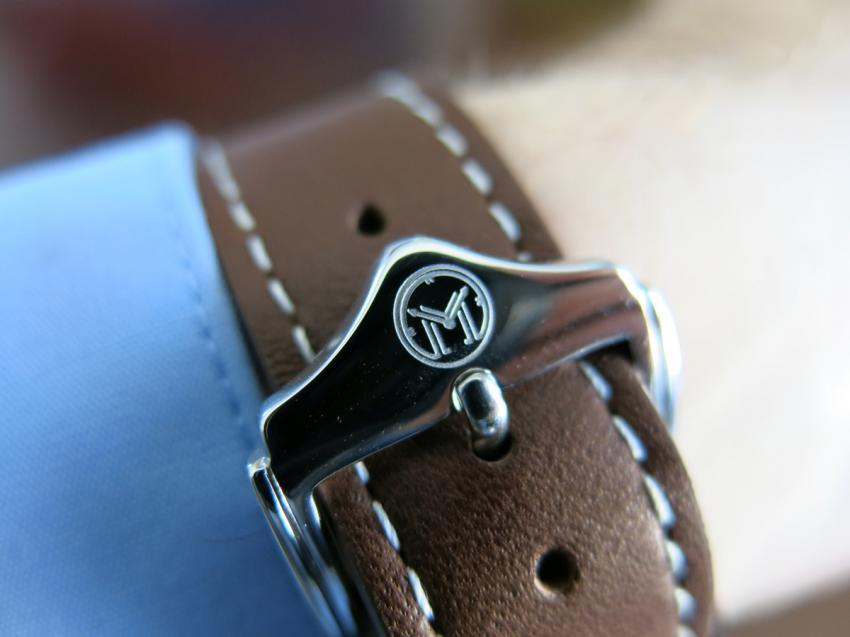 The logo of Melbourne Watch Company engraved on the buckle.