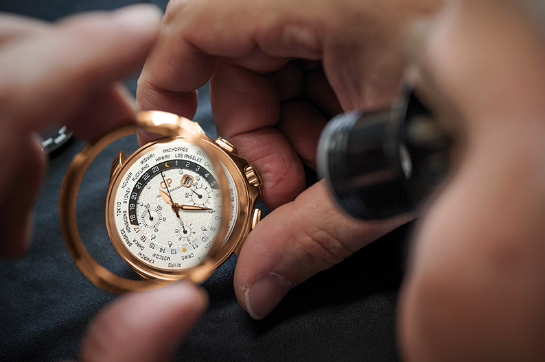 Girard-Perregaux Traveller WW.TC Pink Gold in the hands of a watchmaker.