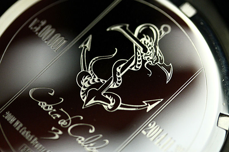 The engraving on the stainless steel back of the Cobra 3.