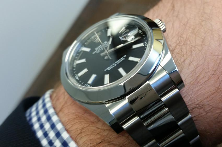 A black dial Rolex Datejust II on TimeCaptain's wrist.