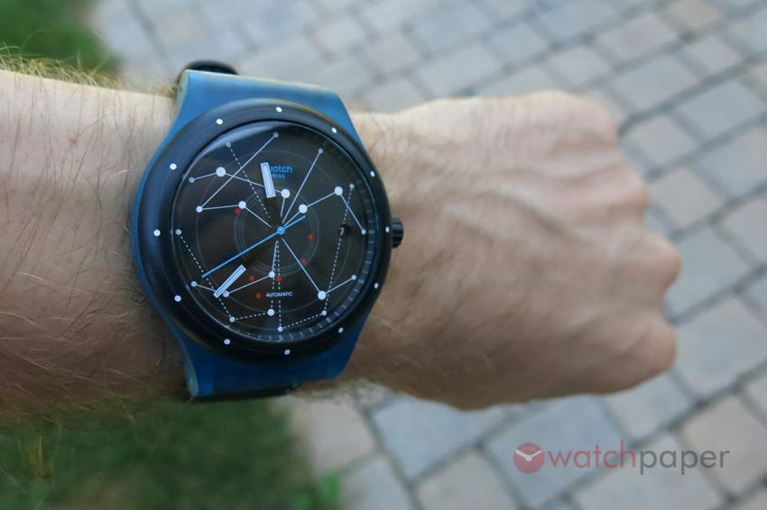 Wrist-shot of the blue Swatch Sistem51