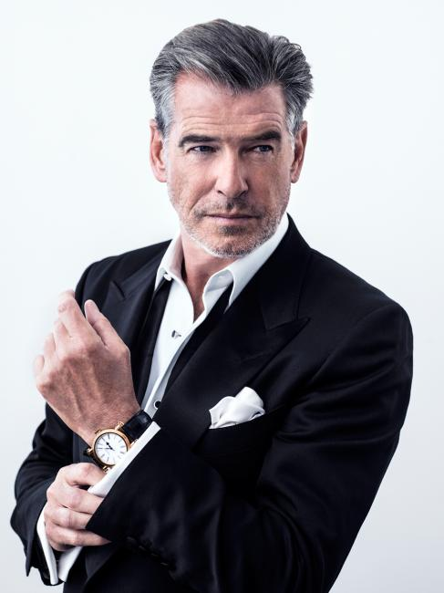 Piece Brosnan and his gold Speake-Marin Resilience.