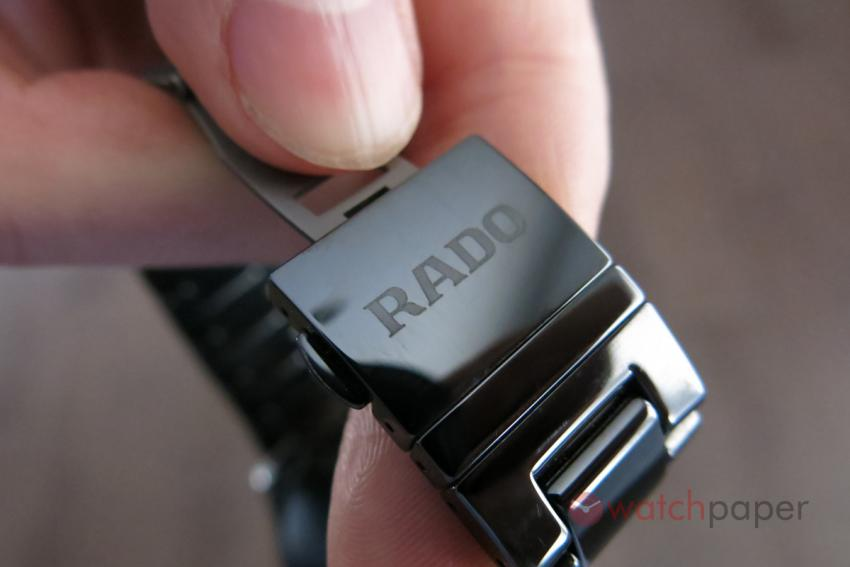 The ceramic cover is engraved with the Rado logo.