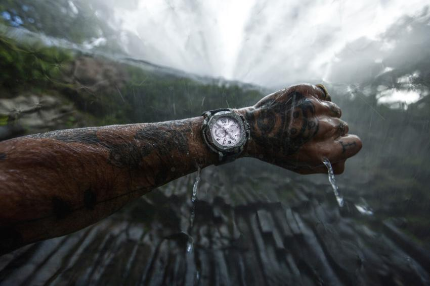 Chris Leidy with a Clerc Hydroscaph Chrono under a waterfall in Queensland, Australia.