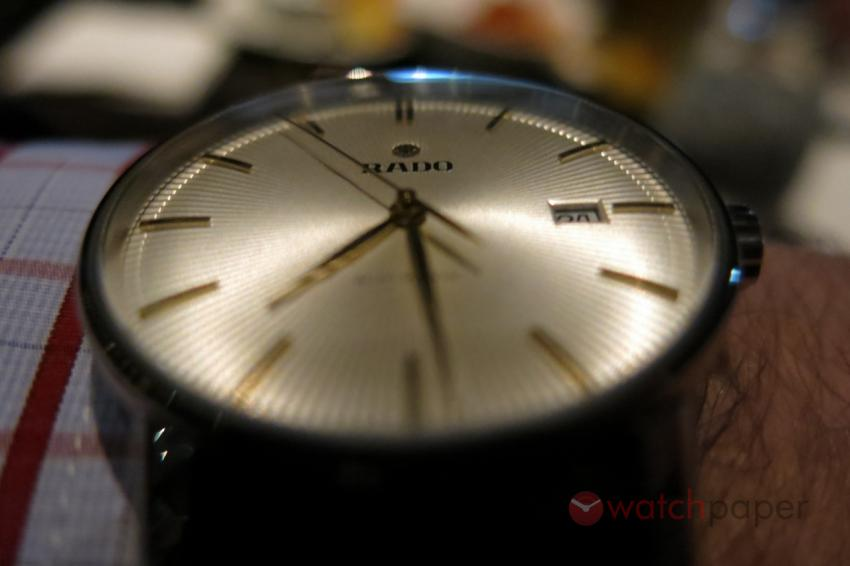 Rado Coupole Classic in the dim light of the steakhouse