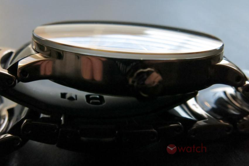 The slightly domed sapphire crystal of the Rado Centrix Automatic Open Heart