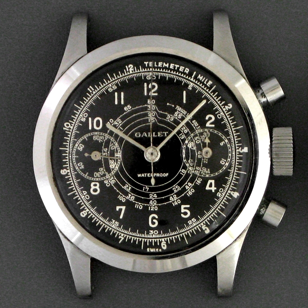 Gallet Clamshell (1943) with military style black dial and telemeter indications for artillery timing.