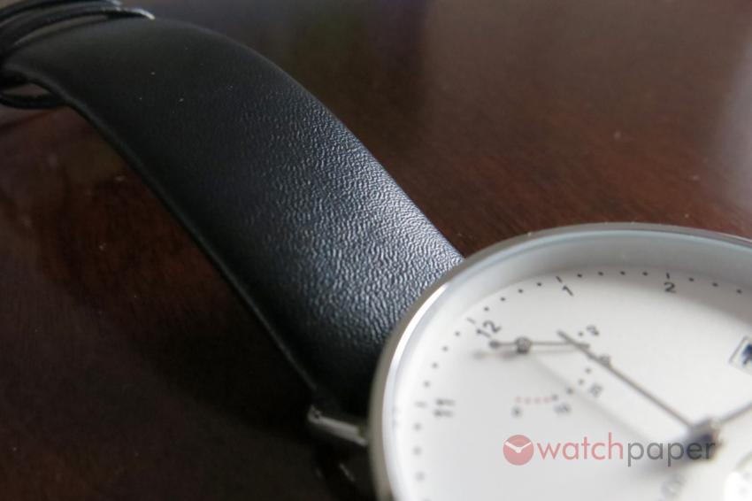 The soft leather strap follows the minimalist design of the Atticus
