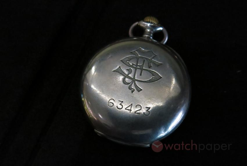 A pocket watch bearing the FS monogram that stands for Ferovia delo Stato, the Italian state-owned railway company. At the bottom you can see the employee number of the first owner.