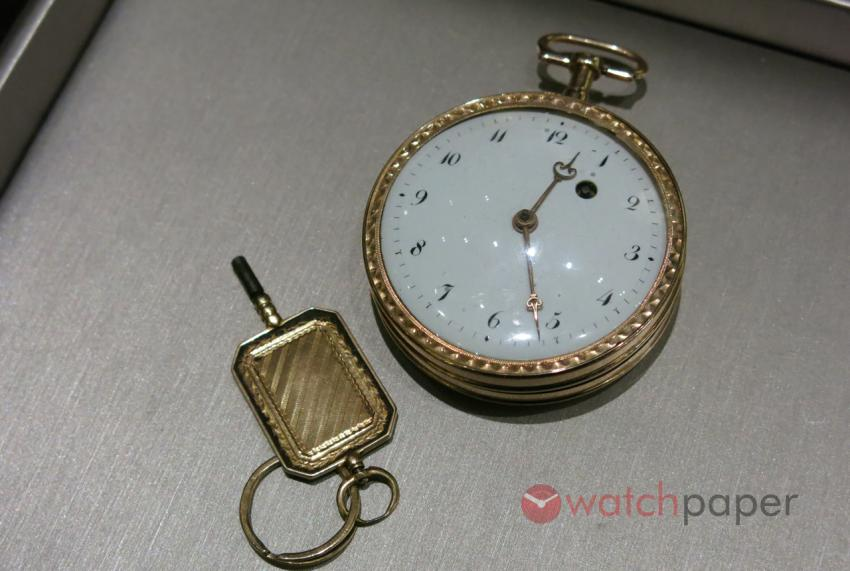 Gold pocket watch with the original winding key.