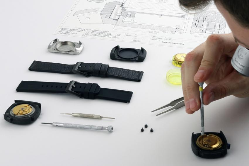 Neonos founder Martin Clowry inspecting components