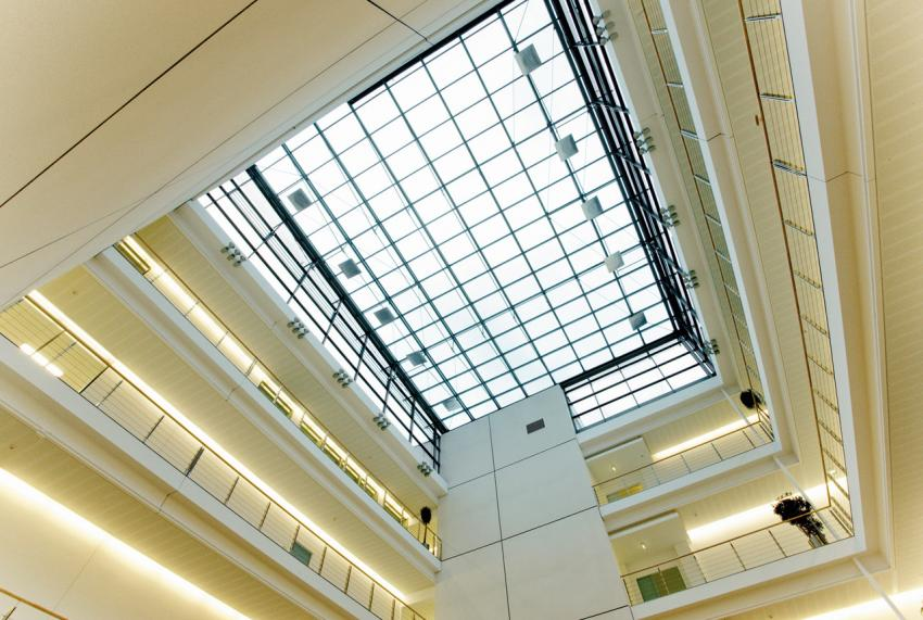 The glass roof of the atrium fills with natural light the entire building.